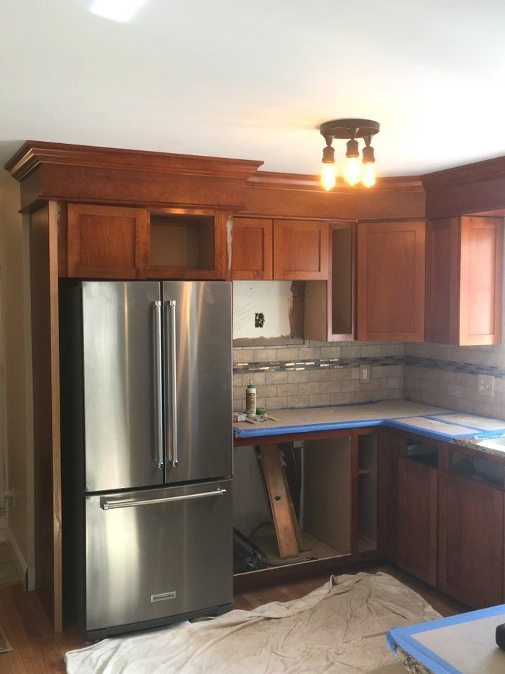 progress on the kitchen with cabinets in now